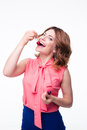 Happy young woman eating cherry Royalty Free Stock Photo