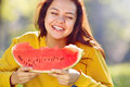 Happy young woman eating watermelon in the park Royalty Free Stock Photo