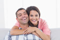 Happy young woman embracing man portrait of women men at home Stock Images