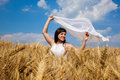 Happy young woman enjoying life in golden wheat field Royalty Free Stock Photo