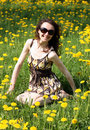 Happy young woman enjoying the sun on a meadow Stock Photo