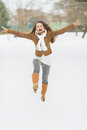 Happy young woman enjoying winter in park Royalty Free Stock Photos