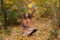 Happy young woman enjoys autumn Royalty Free Stock Photos