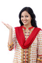 Happy young woman gesturing an open hand against white background Royalty Free Stock Images
