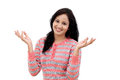 Happy young woman gesturing an open hands against white background Royalty Free Stock Photo