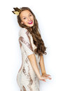 Happy young woman or girl in party dress and crown Royalty Free Stock Photo