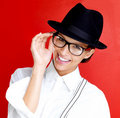 Happy young woman in glasses and hat on white Royalty Free Stock Image