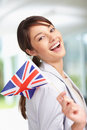 Happy young woman with a Great Britain flag Royalty Free Stock Photo