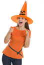 Happy young woman in Halloween hat pointing on you Stock Images