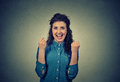 Happy young woman happy exults pumping fists ecstatic celebrates success Royalty Free Stock Photo
