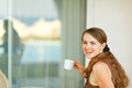 Happy young woman having cup of coffee Stock Photos