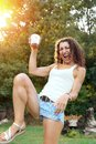 Happy young woman having fun at summer party drinking cocktail at sunset Royalty Free Stock Photo