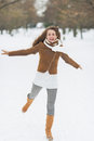 Happy young woman having fun in winter park with long hair Stock Photography