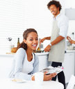 Happy young woman with her husband preparing food Royalty Free Stock Photography