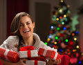 Happy young woman holding Christmas present boxes Royalty Free Stock Images