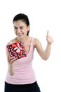 Happy young woman holding gift box Stock Photos