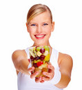 Happy young woman holding glass full of mixed frui Royalty Free Stock Image