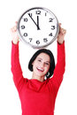 Happy young woman holding office clock Royalty Free Stock Image