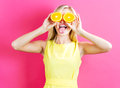 Happy young woman holding oranges halves Royalty Free Stock Photo