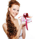 Happy young woman holding the present Royalty Free Stock Image