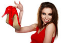 Happy young woman holding a red shoe Stock Images