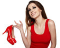 Happy young woman holding a red shoe Royalty Free Stock Photography