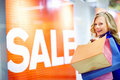 Happy young woman holding shopping bags Stock Photos