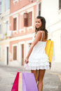 Happy young woman holding shopping bags day just out of center Stock Photo