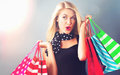 Happy young woman holding shopping bags Royalty Free Stock Photo