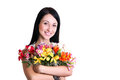 Happy Young Woman Hugging Flowers Royalty Free Stock Images