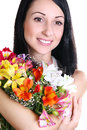 Happy Young Woman Hugging Flowers Royalty Free Stock Photos