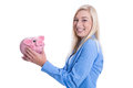 Happy young woman isolated with a pink piggy bank business in blue blouse control of savings Stock Photos