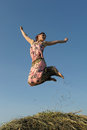 Happy young woman  jumping Royalty Free Stock Photo