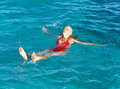 The happy young woman is lapping in the sea Stock Images
