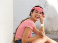 Happy young woman laughing with ice cream cone outside side portrait of a Royalty Free Stock Images