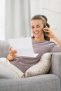 Happy young woman with letter talking cell phone Royalty Free Stock Photo