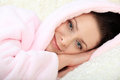 Happy young woman lies relaxing and resting with her head on hands Royalty Free Stock Photography