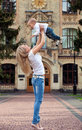 Happy young woman lifting her son high up Stock Photography