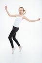Happy young woman listening to music using headphones and dancing cute over white background Royalty Free Stock Photo