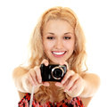 Happy young woman photographer doing photos with still camera isolated on white background Royalty Free Stock Photos