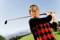 Happy Young Woman Playing Golf Royalty Free Stock Image