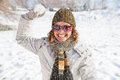 Happy young woman playing snowball fight on the snow day winter concept Royalty Free Stock Photos