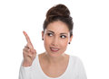 Happy young woman pointing with forefinger isolated on white. Royalty Free Stock Photography