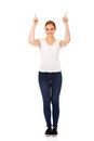 Happy young woman pointing up with both hands Stock Image