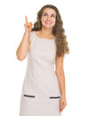Happy young woman pointing up on copy space high resolution photo Royalty Free Stock Photo