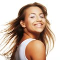 Happy young woman portrait of with wind in hair Stock Image