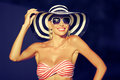 Happy young woman posing in hat and sunglasses Royalty Free Stock Photo
