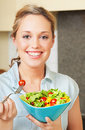 Happy young woman with salad Royalty Free Stock Photos