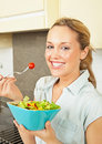 Happy young woman with salad Stock Images