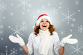 Happy young woman in Santa hat Stock Photos